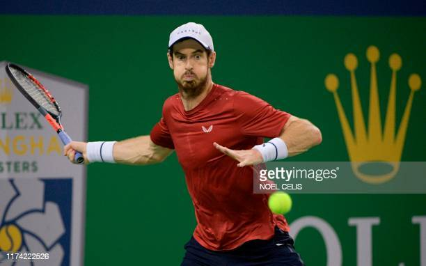 Andy Murray of Britain hits a return against Juan Ignacio Londero of Argentina during their first round men's singles match at the Shanghai Masters...