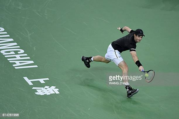 Andy Murray of Britain hits a return against Lucas Pouille of France during their men's singles match at the Shanghai Masters tennis tournament in...