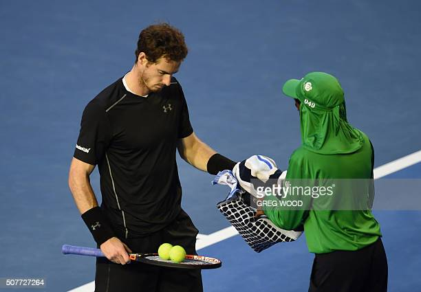Andy Murray of Britain prepares to serve against Novak Djokovic of Serbia in their men's singles final match on day 14 of the 2016 Australian Open...