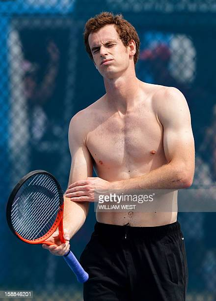 Andy Murray of Britain reacts during a training session at the Brisbane International tennis tournament on January 1 2013 AFP PHOTO/William WEST...