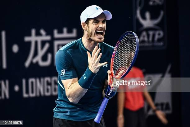 Andy Murray of Britain reacts during his men's singles match against Fernando Verdasco of Spain at the ATP Shenzhen Open tennis tournament in...