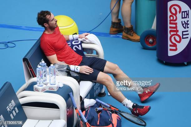 Andy Murray of Britain rests during a changeover during his men's singles second round match against Cameron Norrie of Britain at the China Open...