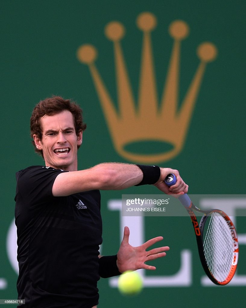 Andy Murray of Britain serves against Jerzy Janowicz of Poland during their men's singles second round match at the Shanghai Masters 1000 tennis tournament held in the Qizhong Tennis Stadium in Shanghai on October 8, 2014.