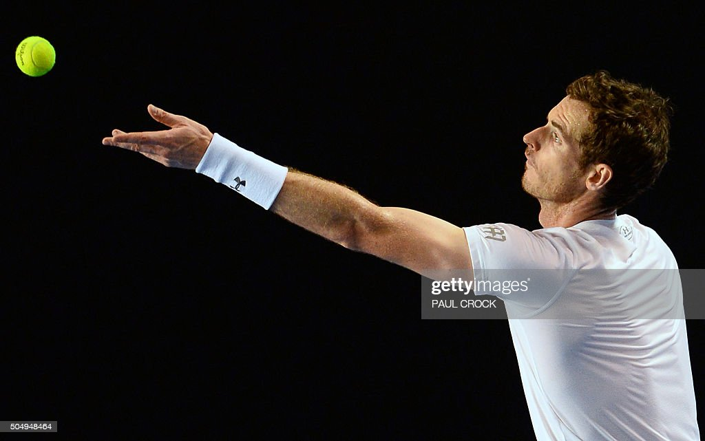 TOPSHOT - Andy Murray of Britain serves during a practice session ahead of the Australian Open tennis tournament in Melbourne on January 14, 2016.