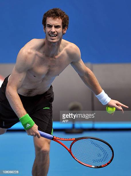 Andy Murray of Britain serves during a practice session one day before the start of the Australian Open tennis tournament in Melbourne on January 16...