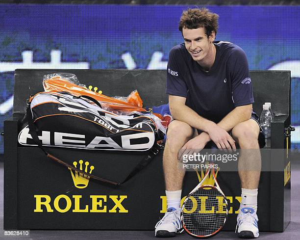 Andy Murray of Britain smiles following his victory over Andy Roddick of the US in their singles match on the second day of the ATP Masters Cup...