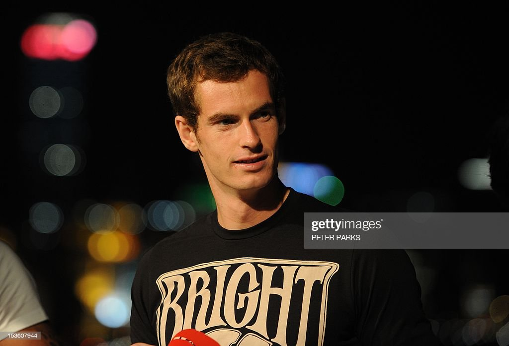 Andy Murray of Britain stands on a rooftop overlooking the Bund, at a sponsors event ahead of the Shanghai Masters tennis tournament in Shanghai, on October 7, 2012. Murray can build on his breakthrough year by becoming the number one player in the world, top-ranked Swiss rival Roger Federer said at an earlier press conference. AFP PHOTO/Peter PARKS
