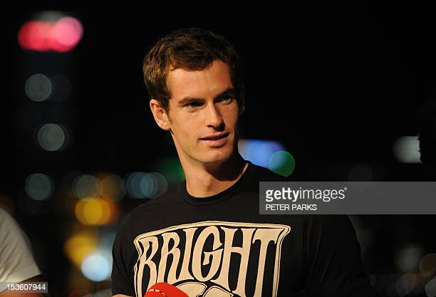 Andy Murray of Britain stands on a rooftop overlooking the Bund at a sponsors event ahead of the Shanghai Masters tennis tournament in Shanghai on...