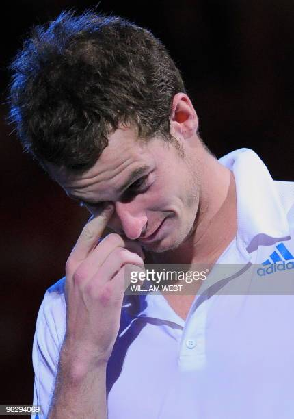 Andy Murray of Britain wipes away the tears during his runnersup speech at the awards ceremony following his loss to Roger Federer of Switzerland in...