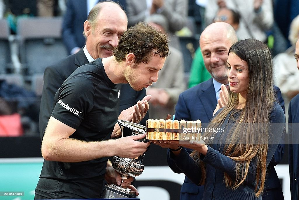 Andy Murray (L) of England holds his trophy as his birthday cake is presented to him after winning the Men's Singles Final match against Novak Djokovic during day eight of The Internazionali BNL d'Italia of ATP Tennis Open at the Foro Italico in Rome, Italy on May 15, 2016.