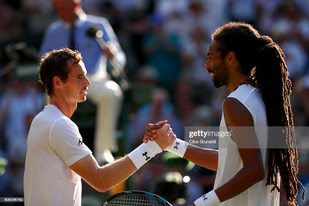 Andy Murray of Great and Dustin Brown of Germany shake hands after their Gentlemen's Singles second round match on day three of the Wimbledon Lawn Tennis Championships at the All England Lawn Tennis and Croquet Club on July 5, 2017 in London, England.