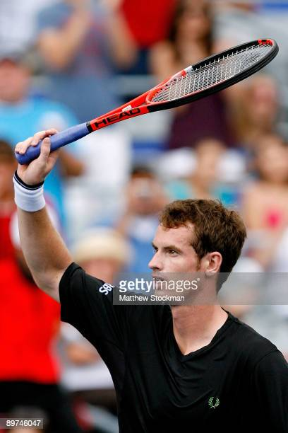 Andy Murray of Great Britain acknowledges the crowd after defeating Jeremy Chardy of France during the Rogers Cup at Uniprix Stadium on August 11...
