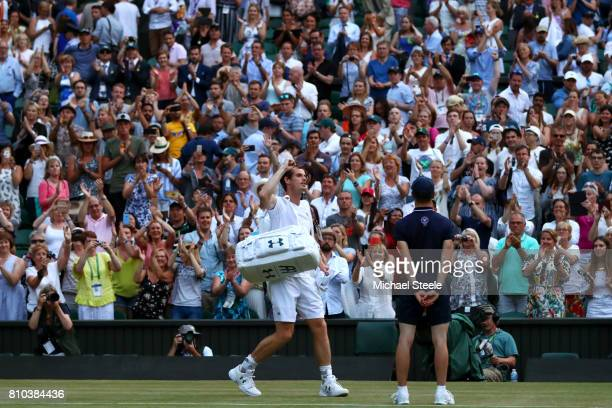 Andy Murray of Great Britain acknowledges the crowd as he celebrates victory after the Gentlemen's Singles third round match against Fabio Fognini of...