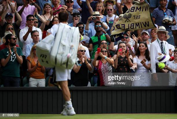 Andy Murray of Great Britain acknowledges the crowd as he walks off court after the Gentlemen's Singles fourth round match against Benoit Paire of...