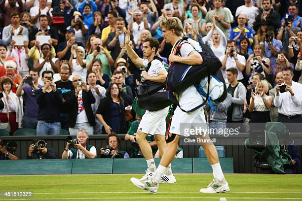 Andy Murray of Great Britain acknowledges the fans as he walks of court along with Kevin Anderson of South Africa after their Gentlemen's Singles...