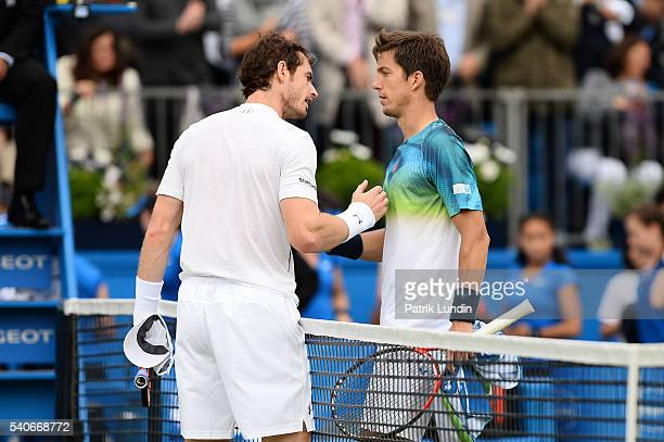 Andy Murray of Great Britain and Aljaz Bedene of Great Britain shake hands after the match on day 4 at Queens Club on June 16 2016 in London England