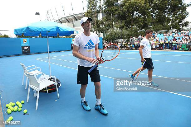 Andy Murray of Great Britain and Daniel Vallverdu prepare for a practice session on day three of the 2014 Australian Open at Melbourne Park on...