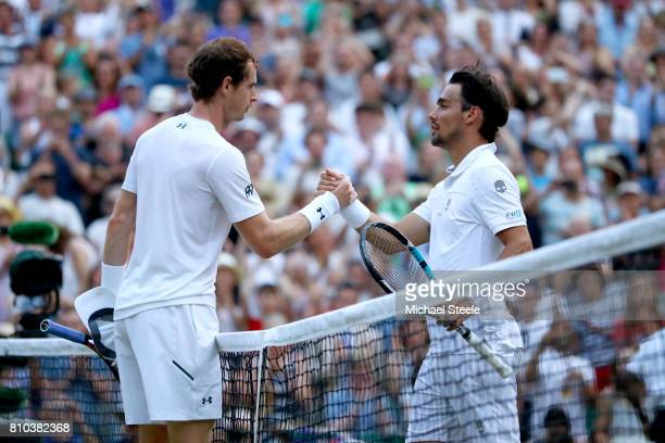 Andy Murray of Great Britain and Fabio Fognini of Italy shake hands after the Gentlemen's Singles third round match on day five of the Wimbledon Lawn...