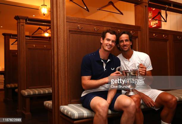 Andy Murray of Great Britain and Feliciano Lopez of Spain pose for a photo with the winners trophy following victory in their doubles final during...