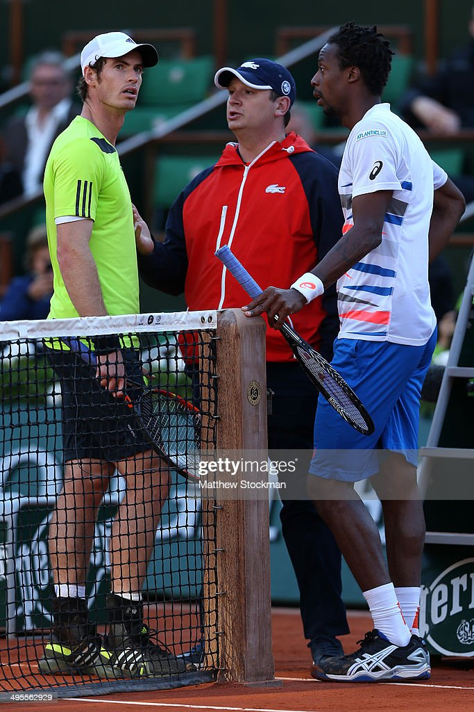 Andy Murray of Great Britain and Gael Monfils of France speak with the chair umpire during their men's singles quarter-final match on day eleven of the French Open at Roland Garros on June 4, 2014 in Paris, France.