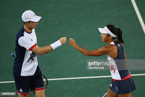 Andy Murray of Great Britain and Heather Watson of Great Britain celebrate victory over Carla Suarez Navarro of Spain and David Ferrer of Spain in...
