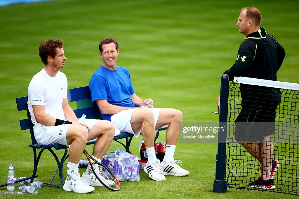 Andy Murray of Great Britain and his coach Jonas Bjorkman of Sweden talk to his strength and conditioning coach Matt Little of Great Britain (r) of during a practice session ahead of the Aegon Championships at the Queens Club on June 14, 2015 in London, England.