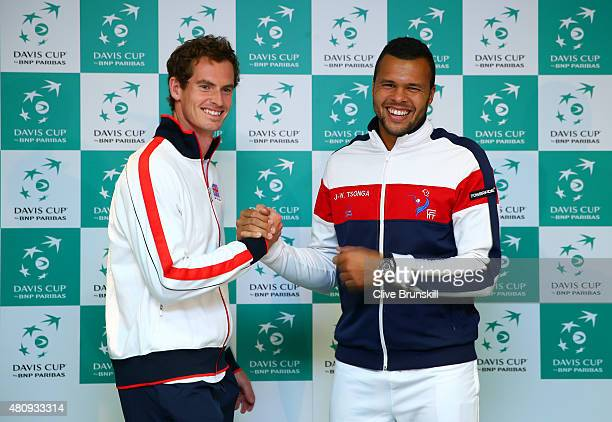 Andy Murray of Great Britain and JoWilfried Tsonga of France shake hands after a press conference during previews to the Great Britain v France Davis...