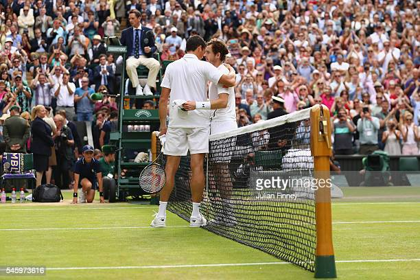 Andy Murray of Great Britain and Milos Raonic of Canada shake hands following the Men's Singles Final on day thirteen of the Wimbledon Lawn Tennis...