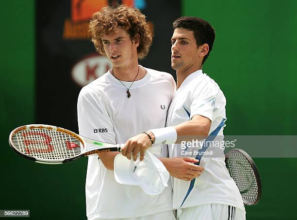 Andy Murray of Great Britain and Novak Djokovic of Serbia and Montenegro celebrate a point in their doubles match against Fabrice Santoro of France...