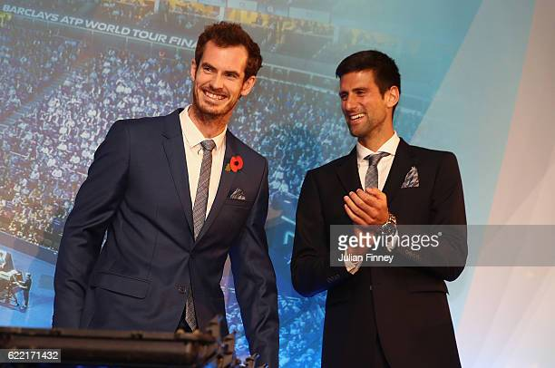 Andy Murray of Great Britain and Novak Djokovic of Serbia watch Thepetebox perform during previews for the Barclays ATP World Tour FInals at the...