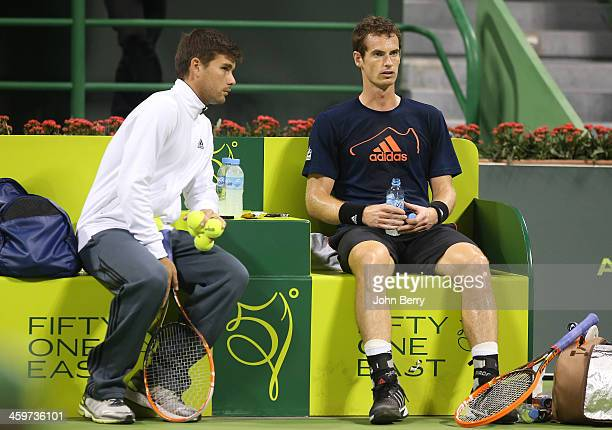 Andy Murray of Great Britain and one of his coaches Daniel Vallverdu practices prior to the Qatar ExxonMobil Open 2014 held at the Khalifa...