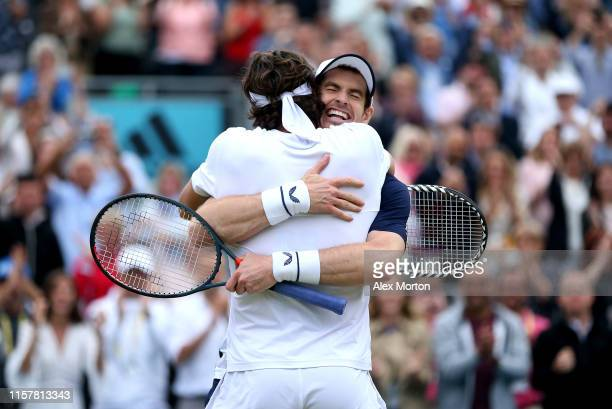 Andy Murray of Great Britain and partner Feliciano Lopez of Spain celebrate match point in the mens doubles final against Rajeev Ram of The United...