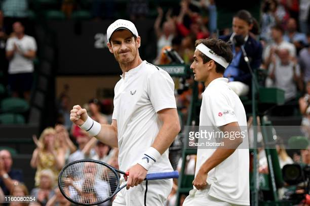 Andy Murray of Great Britain and playing partner PierreHughes Herbert of France celebrate match point in their Men's Doubles first round match...