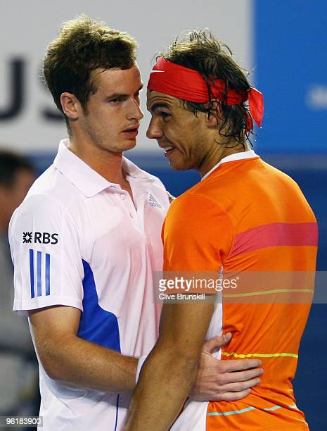Andy Murray of Great Britain and Rafael Nadal of Spain embrace after Nadal retires from his quarterfinal match during day nine of the 2010 Australian...