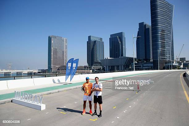 Andy Murray of Great Britain and Rafeal Nadal of Spain pose for a picture during the offical players launch of 2016 Mubadala Tennis Championship at...
