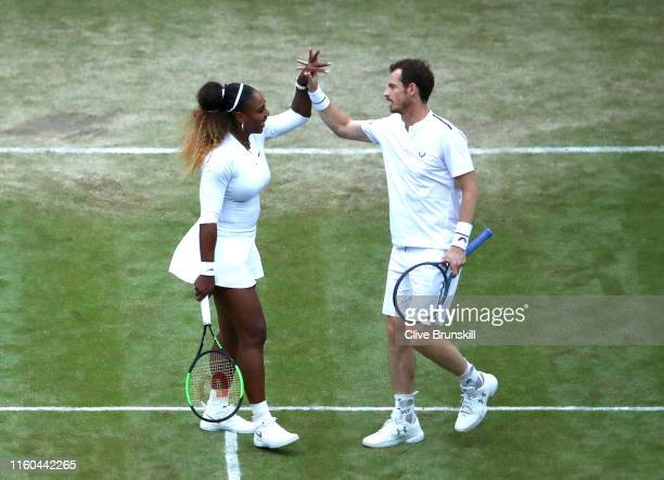 Andy Murray of Great Britain and Serena Williams of The United States celebrate match point during their Mixed Doubles first round match against...