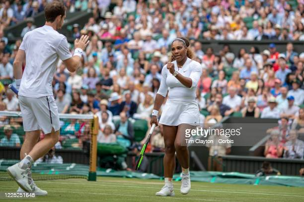 July 06: Andy Murray of Great Britain and Serena Williams of the United States during their match against Fabrice Martin of France and Raquel Atawo...