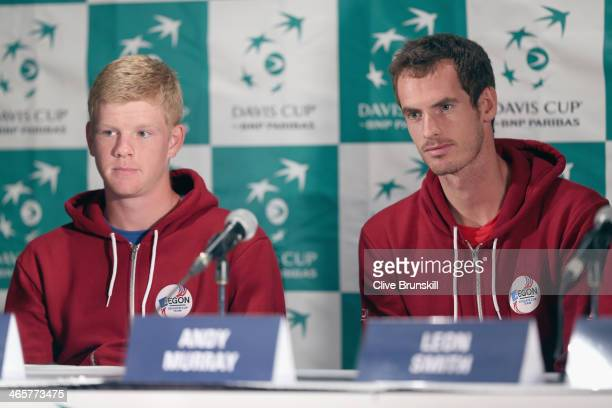 Andy Murray of Great Britain answers questions from the media as team mate Kyle Edmund listens before his first round match against the United States...