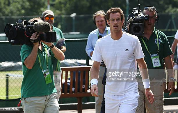 Andy Murray of Great Britain arrives for a practice session on day twelve of the Wimbledon Lawn Tennis Championships at the All England Lawn Tennis...