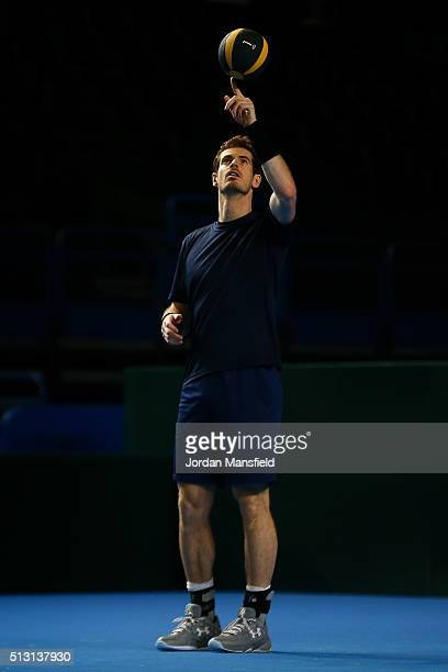 Andy Murray of Great Britain balances a medicine ball on his finger during a practice session ahead of the start of the Davis Cup tie between Great...