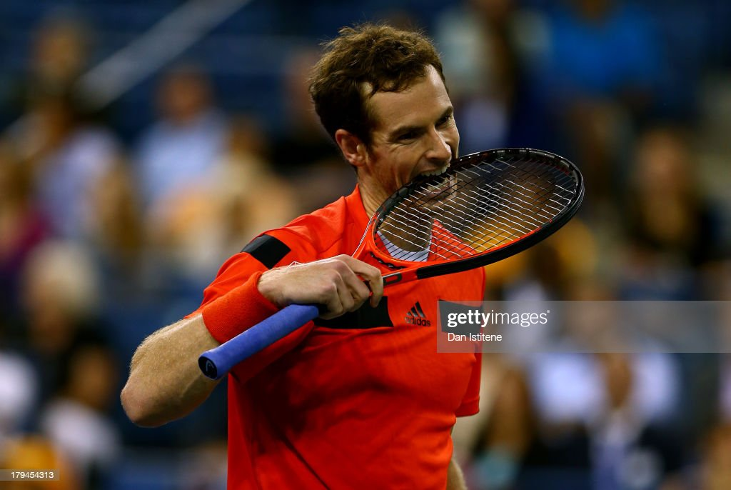 Andy Murray of Great Britain bites his racket during his men's singles fourth round match against Denis Istomin of Uzbekistan on Day Nine of the 2013 US Open at USTA Billie Jean King National Tennis Center on September 3, 2013 in the Flushing neighborhood of the Queens borough of New York City.