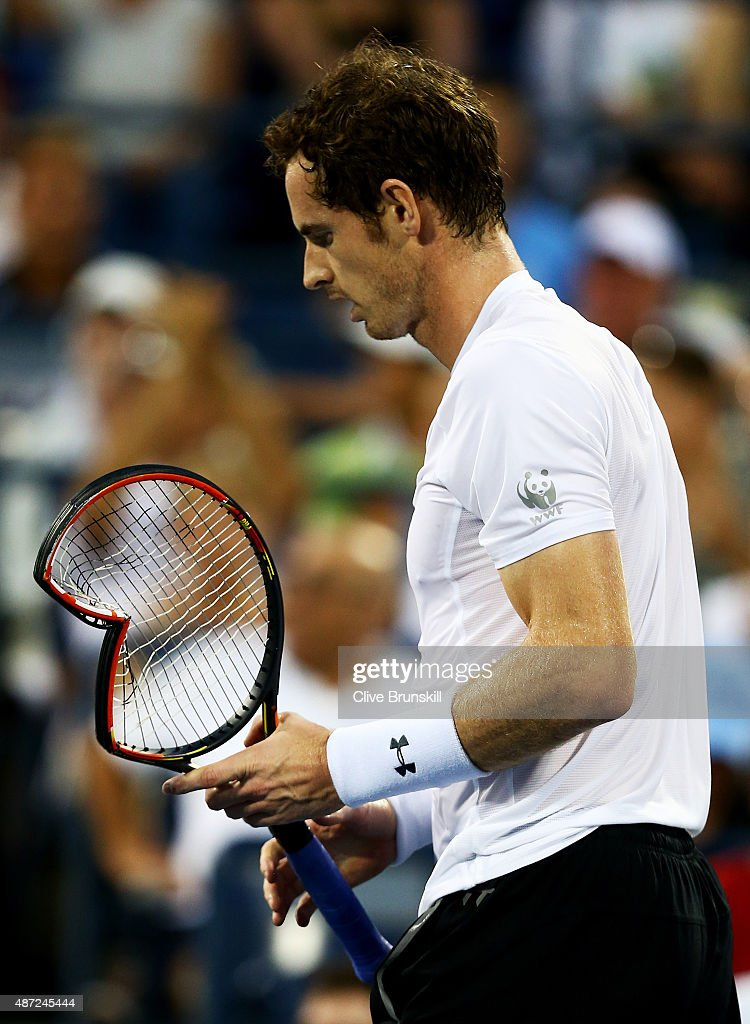 Andy Murray of Great Britain breaks his racket while playing against Kevin Anderson of South Africa during their Men's Singles Fourth Round match on Day Eight of the 2015 US Open at the USTA Billie Jean King National Tennis Center on September 7, 2015 in the Flushing neighborhood of the Queens borough of New York City.