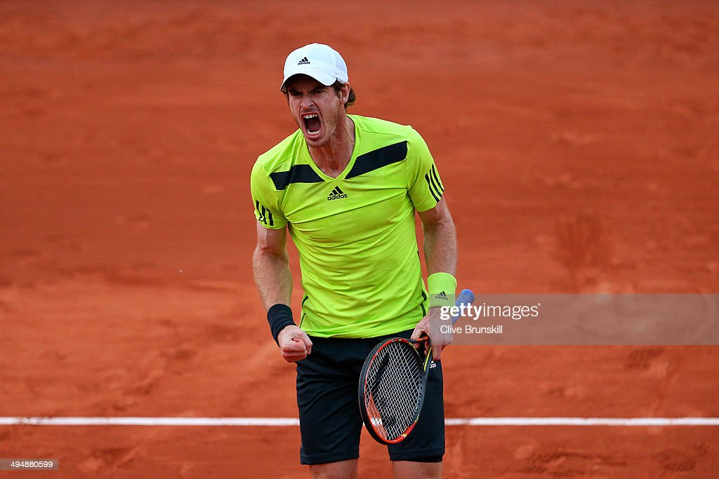 Andy Murray of Great Britain celebrates a point during his men's singles match against Philipp Kohlschreiber of Germany on day seven of the French Open at Roland Garros on May 31, 2014 in Paris, France.