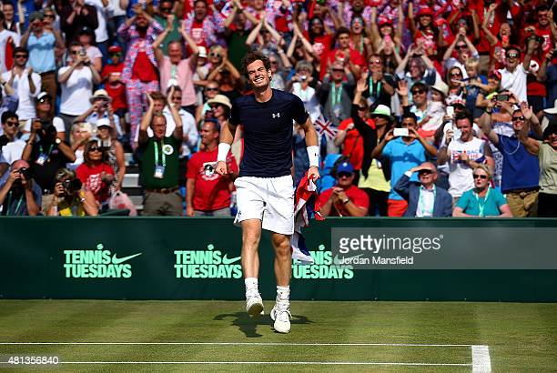 Andy Murray of Great Britain celebrates after defeating Gilles Simon of France on Day Three of The World Group Quarter Final Davis Cup match between...