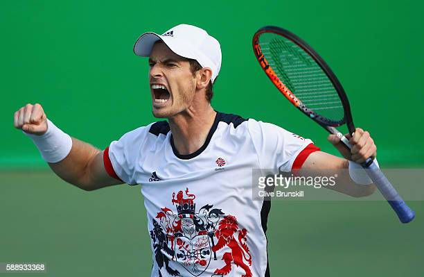 Andy Murray of Great Britain celebrates after defeating Steve Johnson of the United States 6-0, 4-6, 7-6 in the Men's Singles Quarterfinal on Day 7...