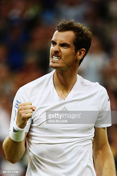 Andy Murray of Great Britain celebrates after winning his Gentlemen's Singles fourth round match against Kevin Anderson of South Africa on day seven...