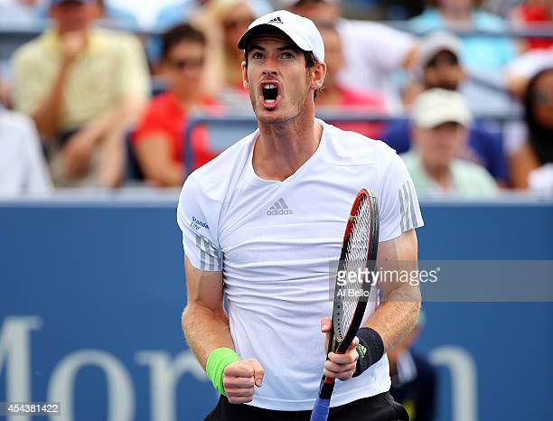 Andy Murray of Great Britain celebrates after winning the second set against Andrey Kuznetsov of Russia during their men's singles third round match...