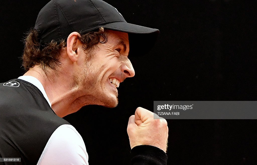 TOPSHOT - Andy Murray of Great Britain celebrates against Serbian Novak Djokovic during the final match of the ATP Tennis Open tournament game at the Foro Italico in Rome on May 15, 2016. / AFP / TIZIANA