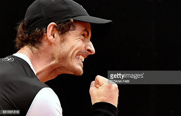 TOPSHOT Andy Murray of Great Britain celebrates against Serbian Novak Djokovic during the final match of the ATP Tennis Open tournament game at the...