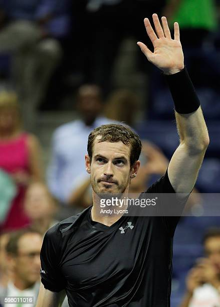 Andy Murray of Great Britain celebrates defeating Lukas Rosol of the Czech Republic during his first round Men's Singles match on Day Two of the 2016...